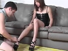 Sexy asian babe masturbating juicy dick with her nice feet