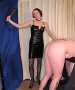 Hot mistress punishing male slave