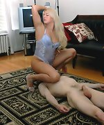 Electra sits on slave`s face