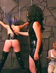 Mistress in latex roping a slave girl in bondage