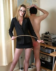 The lady boss was spanking office boy