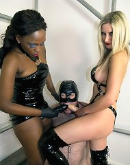 Two fetish dominatrixes pumped a slaveboy by strapons in double style