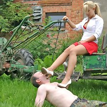 Wife in red skirt trampled and smothered husband outdoor