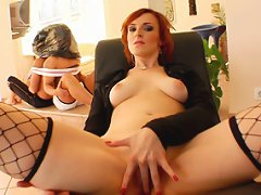 A slutty redhead MILF in a police uniform smother and fucks two younger guys