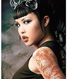 busty tattooed naked Eurasian girl wearing horns