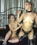 Bald slut gets toy fucked hard