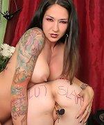 Tattooed brunette abuses her naked slut slave