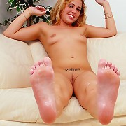 Nikki spreads her legs and her nice toes for some sweet lotion.