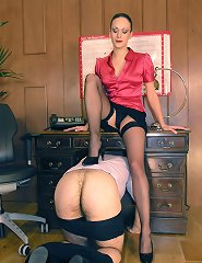 Strict Ms Leias teaches one of her pupils a stern lesson in obedience.