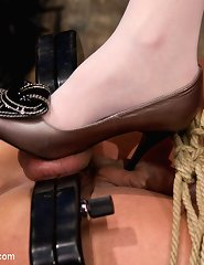 Hot blonde dominatrix objectifies slave by making him into a piece of human furniture and giving him a hard strap-on ass fucking.