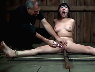 A spreader bar is all it takes to lay Nyssa out and keep her legs opened wide. An old dental gag is perfect for doing the same to her mouth.