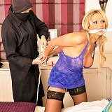 Gorgeous Milf is overpowered and then restrained in her bedroom by cheeky robber who then robs her