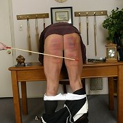 Caning of male bottom