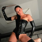 Stunning vixen bitch in rubber - searing caning for unsuspecting guy