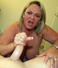 Busty mature tugging dick