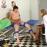 Jerking medical examinee gets footjobbed