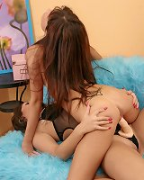 Lesbo holes penetrated by a big strap-on
