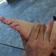 Experienced slave is giving feet massage to his sleeping Mistress