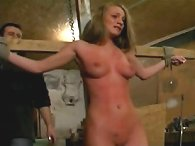 Hung from a cross, Nicole is bullwhipped and flogged with a cat o nine tails till she cries tears in vain
