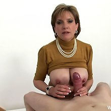 The hot british mature tugging a big cock by her huge tits