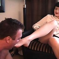 After she walks all over him, he worships her feet