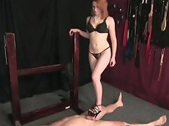 A captive gets to look at his mistress\'s cunt while licking her shoe