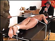 Naked whore tied to Tabled and Caned
