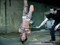 Upside-down bondage besides irritating caning