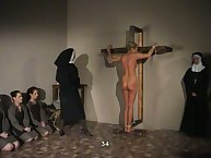 Tied undressed to the Cross and Brutally Punished