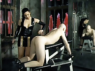 Latex brunette spanked bald man