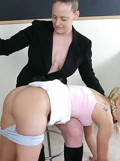 16 of School teacher spanks blond babes ass with pink belt